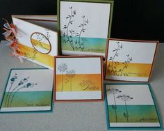 handmade notecard set from Stempel Yvon: Paper Artsy .... one layer ... masked band of color ... meadow flowers stamped on top and over ... beautiful cards ...