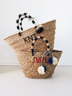 """Our St Tropez tote is made of natural seagrass and features matching raffia poms poms. Roomy enough for your beach towel, sunglasses and more. Measurements: 12""""w x 8.5""""h x 6.5""""d Due to the overwhelmin"""