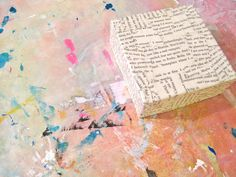How to make a cardboard canvas. Just need a cereal box, newspaper/book pages, tape and Mod Podge. Great when you're on an art budget!
