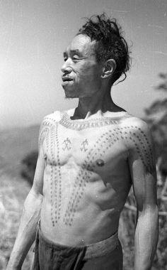 India | Portrait of Chinyang (Konyak Naga) with chest tattoos. Wakching, Sheangha, Nagaland, Mon District. 1937. | ©SOAS, Nicholas Haimendorf