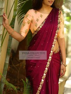 PV 3586 : Peach and Wine.Price : Rs 4300.  Steal the show in this lovely number this season. Wine coloured soft stone studded silk finished with mirror and cut work borders.Unstitched blouse piece : Peach embroidered blouse piece as displayed in the picture.For Order 16 December 2017