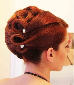 A long red straight coloured updo wedding bridal hairstyle by Panagiotis Keladitis