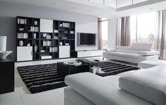 El salón en Casa Carlo es un clásico con la combinación blanco y negro, elegancia y luminosidad.