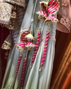 Check some colorful and beautiful latkan for wedding lehenga to make it look more elegent. These latkan designs includes Tassel, beaded and many more. Best Blouse Designs, Dress Neck Designs, Designs For Dresses, Indian Wedding Outfits, Bridal Outfits, Indian Designer Outfits, Designer Dresses, Saree Tassels Designs, Kurti Designs Party Wear