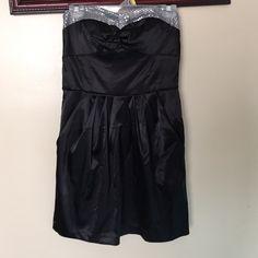 Charlotte Russe Black Strapless Dress NWOT Charlotte Russe Black Strapless Dress with Silver Sequin Top. It even has pockets! Charlotte Russe Dresses