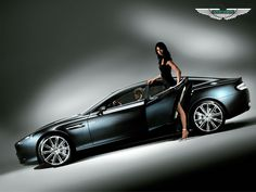 """Aston-Martin Rapide.  In my dream, the young lady in black asks me if I want to """"go for a ride""""... My answer:  """"Nah, I'd rather walk, but thank you anyways for the kind offer"""". (I have really weird dreams!)"""