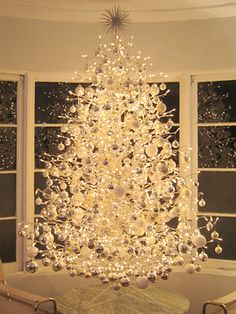 Maison21's stunning DIY Christmas tree cobbled together with bits and pieces of inexpensive flotsam.  Click the picture to learn more about how this elegant tree was created.  -- Eve.