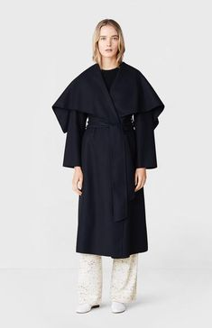 """Wrap up against the winter in this timeless blanket coat with an oversized shawl collar and soft tie belt to cinch in the waist. Cut for a generous fit and designed to move fluidity and be worn effortlessly. Blanket coat.Long sleeves.Shawl collar front & back.Self belt.Splitable.2 side pockets.Split at back. Model wears size: 8, Model height: 5'11"""" / 180cm. 100% Wool Style: PWZ836"""
