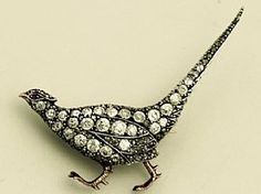 Antique 2.18 carat diamond and 0.01 carat natural ruby, 9 carat yellow gold, silver set pheasant brooch