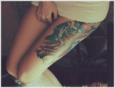 Girl With Colored Tree Thigh Tattoo