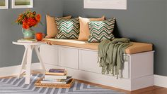 Create a cozy retreat in the corner of a bedroom or along the wall of a family room with problem-solving stock cabinets and easy-to-add trim.