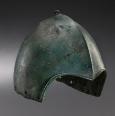 "Rare Scythian Kuban Type Helmet, 7th-6th Century BCThis is a type of Scythian skullcap helmet made of bronze, referred to as ""Kuban"" by scholars (deriving from the name of the Caucasus region from which the largest numbers of specimens were found). They were developed during the 7th and 6th centuries BC and were lighter than contemporary Greek helmets. The helmet's precise origin is still debated: the known examples are relatively few, but the sites where these helmets were found cover..."