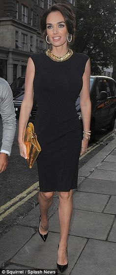 Elegant: Tamara looked stunning in a fitted black dress with a gold necklace and matching clutch bag