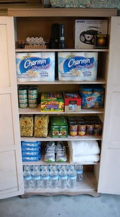 This is what my kit looks like.  It is recommended you have supplies stored in air-tight tubs or on shelves in your garage or basement.  Mine are stored in a cabinet in our garage.  It holds all of our essentials and it is easy access to the kitchen if I need to replace or store extra items.  I also keep a duffel bag on top just in case I need to leave my house during an emergency.