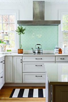 Love the color of the tile in this kitchen!