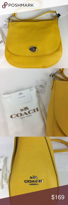 """NWT Coach Turnlock Hobo Bag Condition: New, with Tags and Dust Bag. A few very tiny (pin head size) light marks from handling on bag. Nothing that would show up in a photo or you can see unless you look for them.  The new and versatile Turnlock Hobo in plump pebble leather has a soft hand and a luxe sheen. Its Long strap with 22 3/4"""" drop can be used for crossbody. 13"""" (L) x 11 1/2"""" (H) x 3 3/4"""" (W).  Inside zip, cell phone and multifunction pockets. Handles with 10 1/2"""" drop   Thank you for…"""