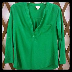 Pull over top This emerald green top is a great color without being too bold. This top is a rayon cotton blend giving it just the right balance. It had button tabs in the sleeves to allow you to get that perfect slouchy rolled sleeve look and the ability to fasten it to last all day. This super chic top is waiting for you. Merona Tops Blouses