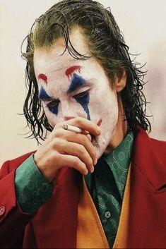 Joker is a movie starring Joaquin Phoenix, Robert De Niro, and Zazie Beetz. In Gotham City, mentally troubled comedian Arthur Fleck is disregarded and mistreated by society. Comic Del Joker, Le Joker Batman, Joker And Harley Quinn, Batman Comics, Joaquin Phoenix, Art Du Joker, Der Joker, Photos Joker, Joker Images