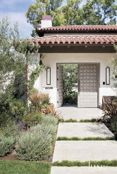 Contemporary White Front Elevation with Mahogany Doors