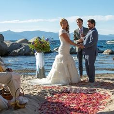 Gorgeous Couple, Picture Perfect Day & Flyboy Naturals Rose Petals on the sand at this beach wedding Lake Tahoe, CA #aislepetals #beach #beachwedding #rosepetals #petals  #weddingpetals #love www.flyboynaturals.com Beach Wedding Inspiration, Lake Tahoe, Rose Petals, Couples, Wedding Dresses, Lace, Fashion, Bride Dresses, Moda