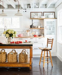 Eclectic country kitchen. Photo by Max Kim-Bee via Country Living