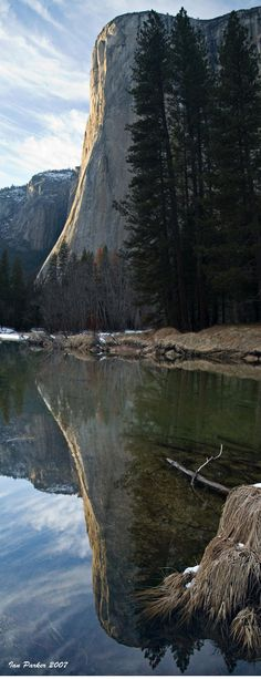 El Capitan is a vertical rock formation in Yosemite National Park, located on the north side of Yosemite Valley, near its western end. The granite monolith extends about 3,000 feet (900 m) from base to summit along its tallest face, and is one of the world's favorite challenges for rock climbers.
