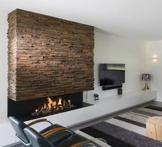 Incredible Contemporary Fireplace Design Ideas - Natural or artificial fireplace models can make both modern and rustic home decorations look highly aesthetic. Artificial fireplace models are general… - Fireplace Tv Wall, Modern Fireplace, Living Room With Fireplace, Fireplace Ideas, Contemporary Fireplace Designs, Contemporary Bedroom, Contemporary Office, Artificial Fireplace, Indoor Outdoor Fireplaces