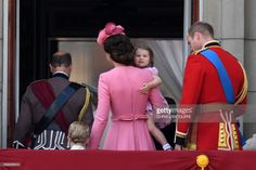 Britain's Catherine, Duchess of Cambridge (C) carries her daughter Princess Charlotte of Cambridge as she leaves the balcony of Buckingham Palace with Britain's Prince William, Duke of Cambridge, (R), Britain's Prince Edward, Earl of Wessex, (L) and her son Prince George after watching a fly-past of aircraft by the Royal Air Force, in London on June 17, 2017.The ceremony of Trooping the Colour is believed to have first been performed during the reign of King Charles II. In 1748, it was…
