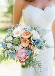 Wedding from Wren & Field Photography Peach garden roses, pale pink peonies, sagey succulents and light blue delphinium. So pastel paradise!Peach garden roses, pale pink peonies, sagey succulents and light blue delphinium. So pastel paradise! Blue Purple Wedding, Floral Wedding, Trendy Wedding, Peach Wedding Bouquets, Cornflower Wedding Bouquet, Rustic Wedding, Bridal Bouquet Blue, Purple Bouquets, Orange Wedding