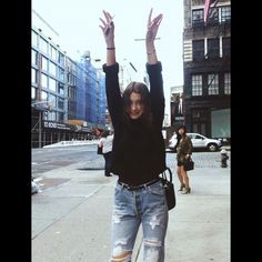 Bella Hadid - black croped sweater, high waisted ripped bf jeans.
