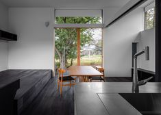 Blackened timber retreat by Studio Aula built in woods near Tokyo