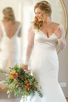 This custom wedding dress features a v-neckline wedding dress style with long sleeves and lace detail. The pearl draping in the back adds to this whimsical wedding dress. #trumpetweddingdress #laceweddingdress #wedding #weddingdress #designerweddingdress #bride #bridalgown Wedding Bride, Wedding Gowns, Wedding Day, Custom Wedding Dress, Designer Wedding Dresses, Long Sleeve Wedding, Beaded Lace, Lace Applique, Appliques