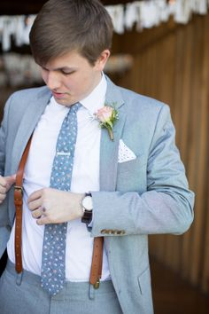 We love that this groom opted in for a light blue suit! Photo by Susan Hudson on Engaged and Inspired