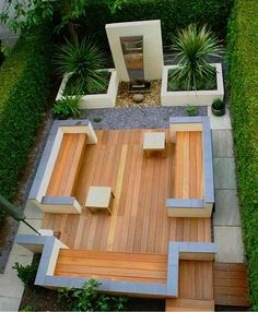Decking, rocks, water feature and greenery.