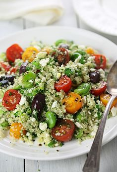 Bulgur salad with fava beans, cherry tomatoes, olives and feta