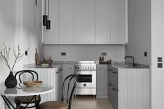 A minimal kitchen in shades of grey