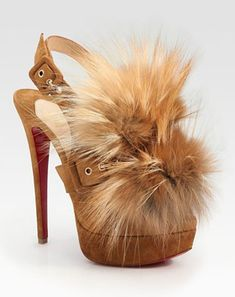 Christian Louboutin splash suede and fox fur peep toe pump from fall 2011 collection.