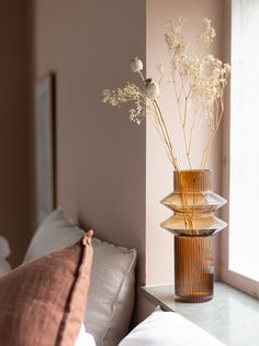 my scandinavian home: My Latest Bedroom Update (+ Get The Look!) dried flowers in an amber vase with pink-brown backdrop