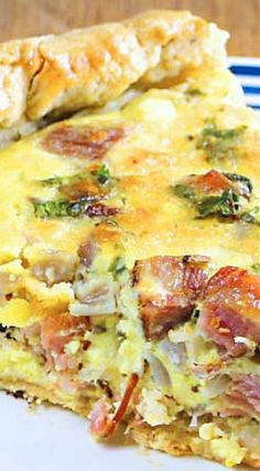 Cast Iron Quiche with Ham & Sharp Cheddar Cheese _ Awesome! Savory black pepper olive oil crust stuffed with ham & sharp cheddar cheese. Satisfying for even the hungriest diner! In keeping with a cast iron philosophy, I kept the seasoning straightforward!