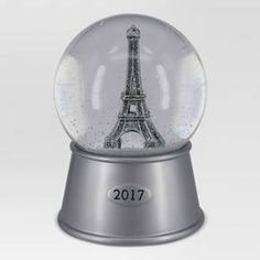 Decorate your space with Parisian style with the Eiffel Tower Snow Globe from Threshold™. With a silver base, this glitter snow globe features a replica of the iconic Eiffel Tower, complete with glittering accents. Shake up this snow globe to watch the glitter swirl and fall as you dream wistfully about your next trip to France.
