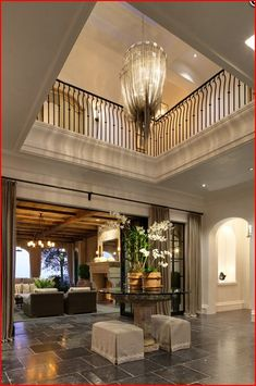 Two-story foyer with gorgeous chandelier