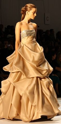 Christian Siriano.  Beautiful gold couture ball gown