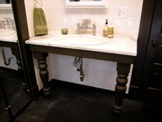 Stuck on a vanity idea? A couple of painted table legs are all you need. (Well, and a framework for support, especially if your countertop choice is heavy.) This BATHtastic! redo pared an overwrought blue-tiled bathroom down to a neutral palette and minimalist vanity choices, leaving the sparkling chrome plumbing exposed underneath.