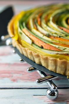 Spiral Vegetable Tart: thinly sliced vegetables are the visual star of this edible artwork. With a layer of homemade sundried tomato pesto and a flaky pie crust, this tart is as delicious as it is beautiful! Vegan and gluten free options, too! Vegetable Tart, Vegetable Recipes, Thanksgiving Vegetable Sides, Vegan Thanksgiving, Clean Eating Snacks, Healthy Snacks, Healthy Recipes, Clean Recipes, Cooking Recipes