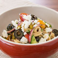 Japanese udon noodles and katsu sauce add a delicious twist to this Greek pasta salad. Sprinkle with feta before serving.