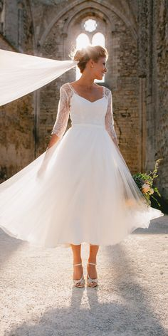 21 Incredible Tea Length Wedding Dresses is part of Midi wedding dress - Tea length wedding dresses are invented for small and sassy brides who want a sexy look These style of dresses will underline your features, make you Wedding Dress Tea Length, How To Dress For A Wedding, Classic Wedding Dress, Tea Length Dresses, Wedding Dress Sleeves, Perfect Wedding Dress, Wedding Dress Midi, Wedding Dresses Simple Short, Cocktail Wedding Dress