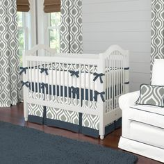 Raindrops are a few of my favorite things, especially when they are part of our Gray and Navy Raindrops collection. This contemporary bedding collection is sure to be one of your favorites as well. From the pleated peek-a-boo skirt to the cozy comforter backed with our soft plush minky, this is a must-have for your nursery. Featuring shades of gray, navy and white this collection will grow right along with your little one for years of enjoyment.  2-Piece Crib Bedding Set includes: (1) Solid…