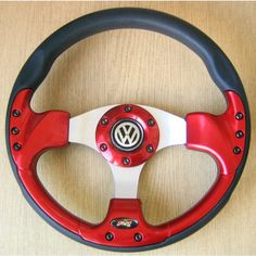 Red Sports Steering Wheel for VW Golf GTI Polo Red Sports Steering Wheel VW Golf GTI Polo Customized horn button in the center of the steering wheel supplied on request. There is a logo of the manufacturer T-HORN on the steering wheel. Volkswagen Golf Mk1, Vw, Golf Mk2, Sport Seats, Sports, Slammed, Cars, Passion, Logos
