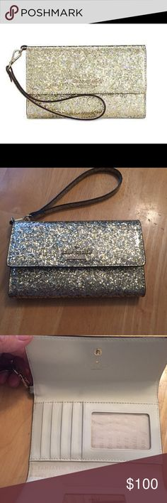 Kate spade gold glitter bug wristlet Kate Spade gold glitter bug wristlet for iPhone 6. Excellent condition showing no signs of wear. Looking to trade for a gold glitter Lacey only. kate spade Bags Clutches & Wristlets