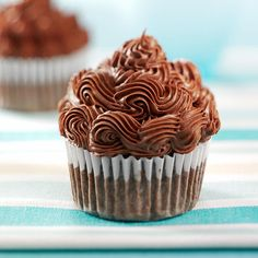 Cocoa Banana Cupcakes Recipe -Rochelle Brownlee of Big Timber, Montana shares the recipe for these moist cupcakes with milk banana flavor. The cocoa powder in the frosting boosts the chocolate flavor while the melted chocolate gives it a creamy texture, making it easier to spread.
